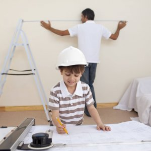 Happy father and son refurbishing home together